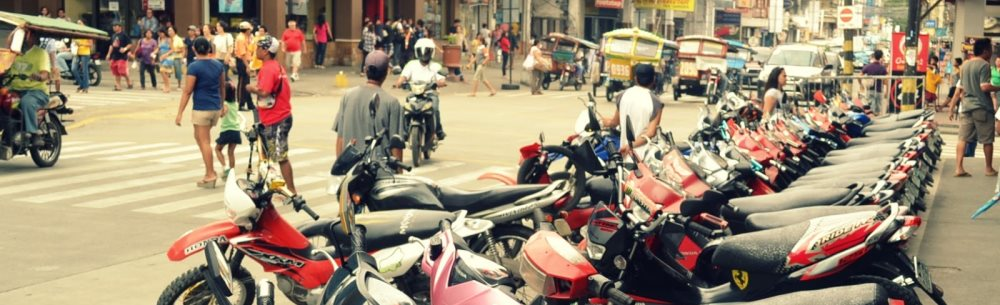 Dumaguete, Philippines - Motorbikes lined up on Perdices