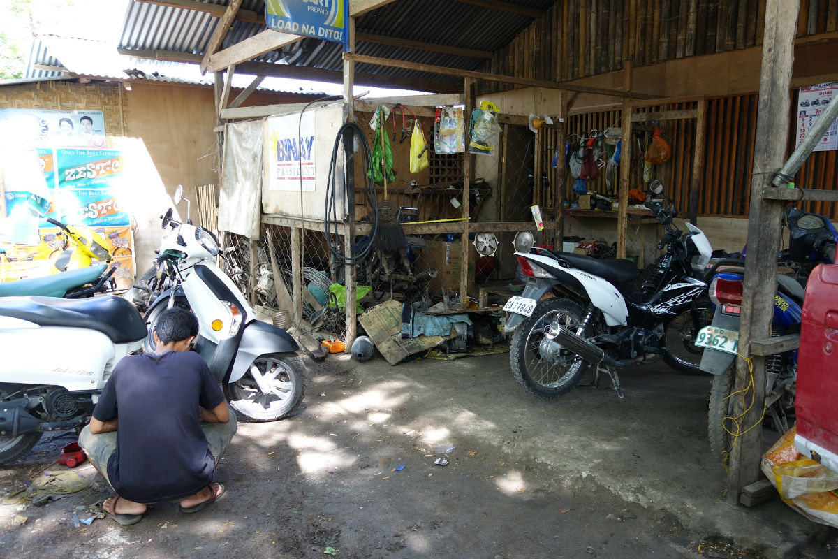 Fixing the rental bike in Bohol